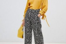 With yellow blouse, yellow bag and white pumps