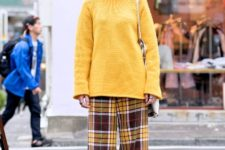 With yellow oversized sweater, tote and brown boots