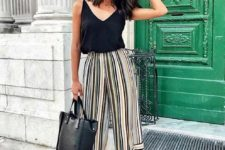 02 a black top, colorful striped culottes, black strappy shoes and a blakc tote for a hot day