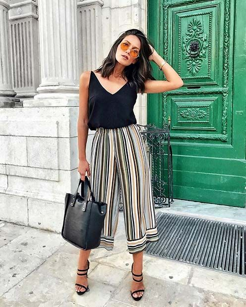 a black top, colorful striped culottes, black strappy shoes and a blakc tote for a hot day