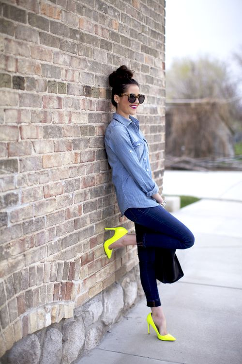 a chambray shirt, navy skinnies, neon yellow heels and a black bag
