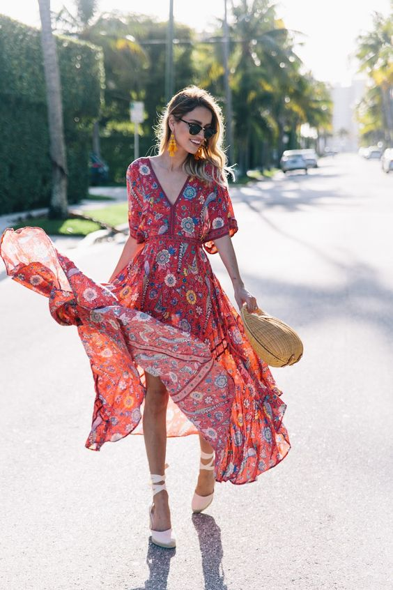 a red printed midi dress with short sleeves, a straw hat and white espadrilles for an ultimate boho look