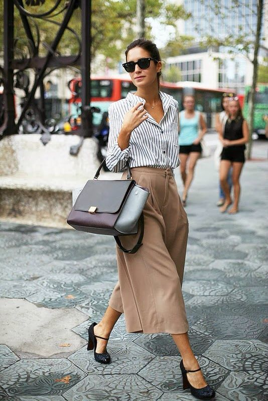 a striped button down, camel high waisted culottes, black shoes and a large comfy bag
