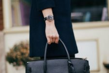 02 a stylish black leather tote with a tassel is a very comfy and classic item for work