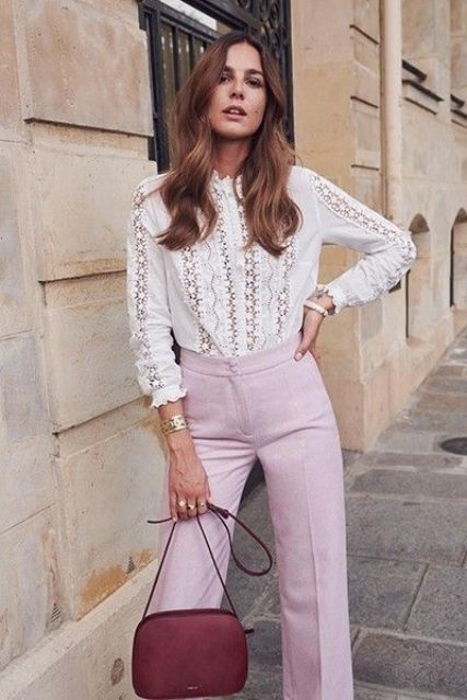 a white cotton lace blouse with a high neckline, long sleeves, pink  pants and a red bag