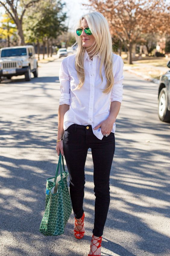 a white oversized shirt, black skinnies, red lace up shoes and a green tote