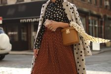 02 an all-polka dot outfit with a blouse, a midi skirt, a coat and nude and black heels for a retro feel