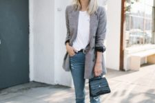 02 blue ripped skinnies, a white tee, black bow heels, a black bag and a grey oversized blazer