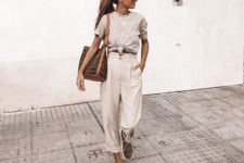 02 off-white cargo pants, a grey tee, grey platform shoes and a brown bag for summer