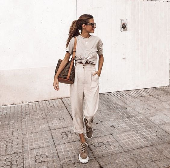 off white cargo pants, a grey tee, grey platform shoes and a brown bag for summer