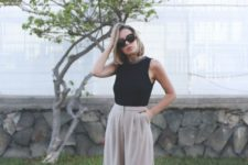 03 a black sleeveless top, grey culottes, leopard print shoes make up a laconic outfit