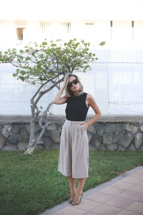 a black sleeveless top, grey culottes, leopard print shoes make up a laconic outfit