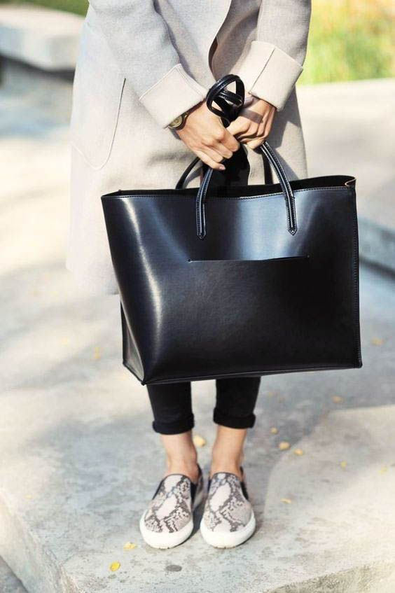 a large partly shiny and partly matte black tote si a very comfortable option