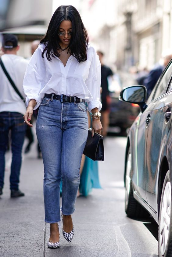a white button down, blue mom jeans, printed slingbacks and a black clutch