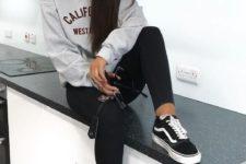 03 black skinnies, a grey printed sweatshirt, black Vans shoes for a trendy look