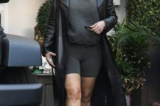 03 grey bike shorts and a matching hoodie, heels and a black leather trench by Kim Kardashian