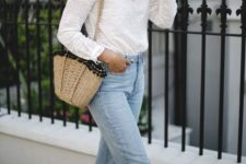 03 light blue mom jeans, a white cotton lace blouse with a turtleneck and long sleeves, wedges and a woven bag