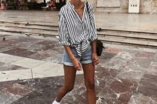 03 mini denim shorts, a striped black and white oversized button down, white sneakers and a black bag