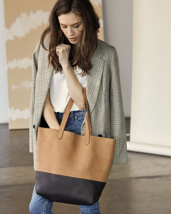 a camel and brown leather tote bag is a comfy and neutral idea to go to the office