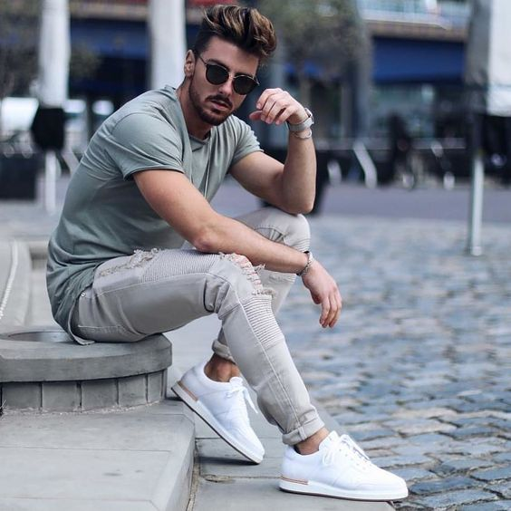 a green tee, grey ripped skinnies, white trainers and sunglasses to feel ultimate comfort