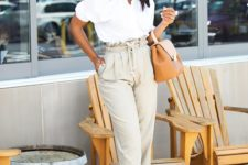 04 a white button down with short sleeves, off-white high waisted pants, black heels and a camel bag