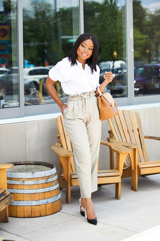 a white button down with short sleeves, off-white high waisted pants, black heels and a camel bag