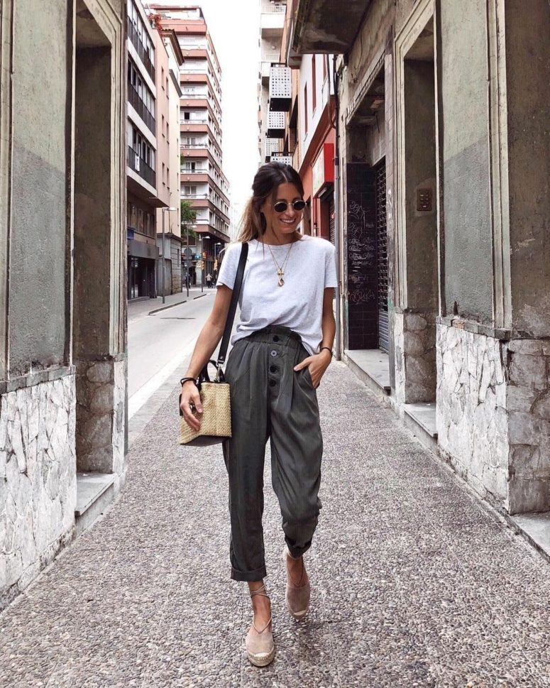 a white tee, graphite grey cargo pants, blush espadrilles and a small wicker bag