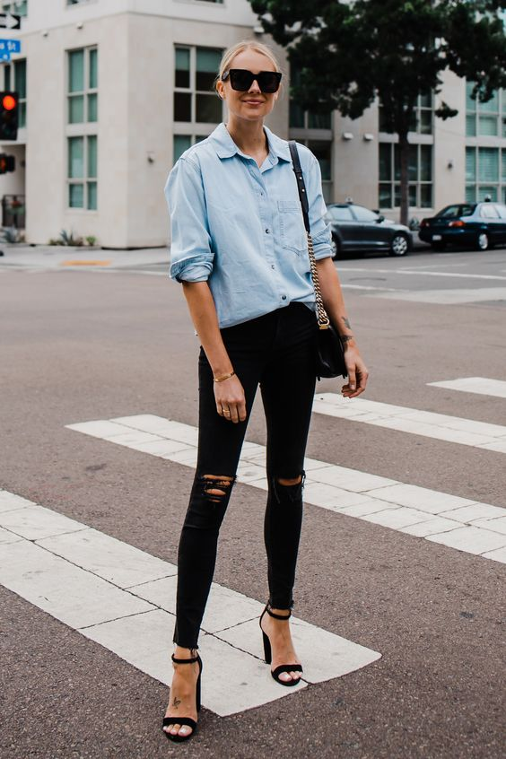 black ripped skinnies, an oversized chambray shirt, black block heels and a black bag