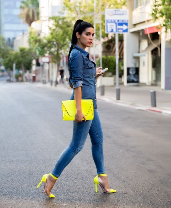 blue skinnies, a chambray shirt, a neon yellow clutch and matching heels