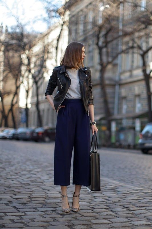 navy culottes, a grey tee, printed shoes, a black leather jacket and a black tote