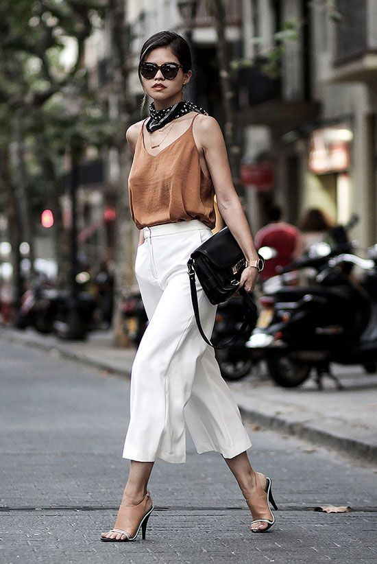 a flawless look with a rust cami top, white culottes, nude mule sandals and a black bag for summer