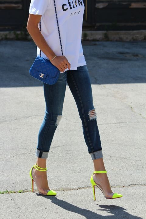 a graphic white tee, ripped blue denim, neon yellow heels and a bright blue crossbody
