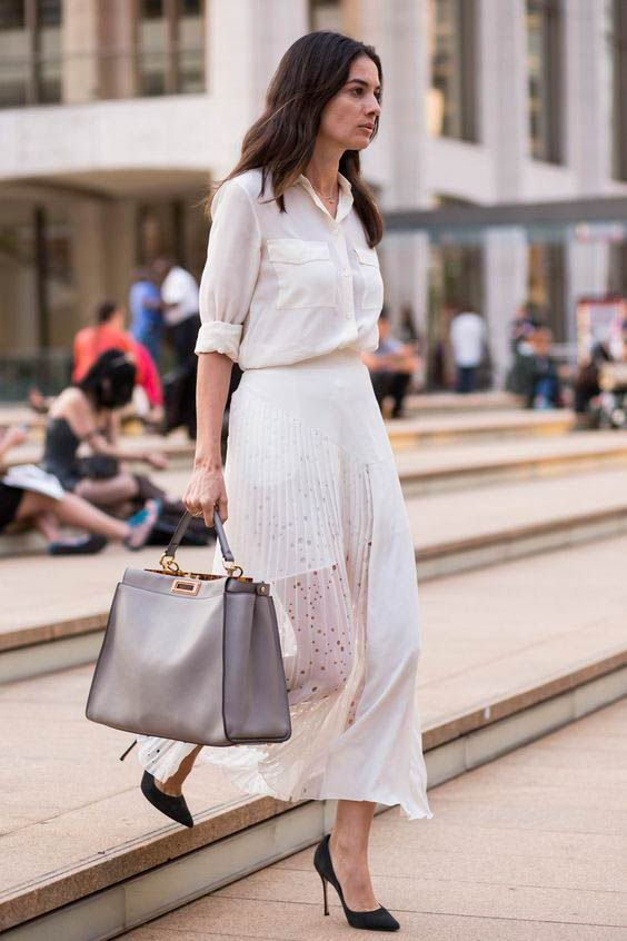 a large grey tote bag with gold detailing is a chic and neutral idea to go for