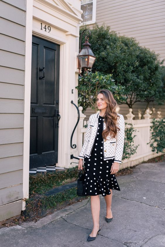 a retro look with polka dots, a fit and flare black and white dress, a Chanel jacket, a black bucket bag