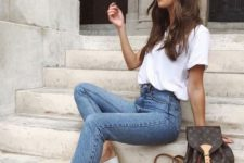 05 a white tee, blue high waisted skinnies, white loafers and a brown backpack for a comfy summer look