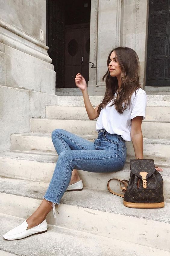 a white tee, blue high waisted skinnies, white loafers and a brown backpack for a comfy summer look