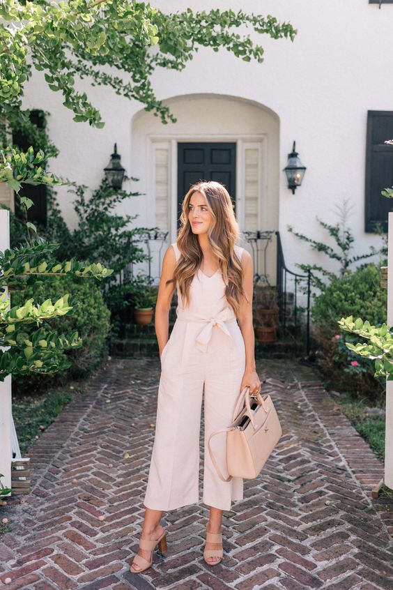 a blush cropped sleeveless jumpsuit, blush mules, a light pink tote for a preppy and girlish work look