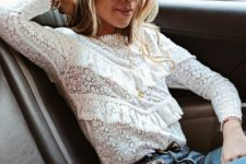 06 a white lace and ruffled blouse with long sleeves, blue jeans and a leopard print bag