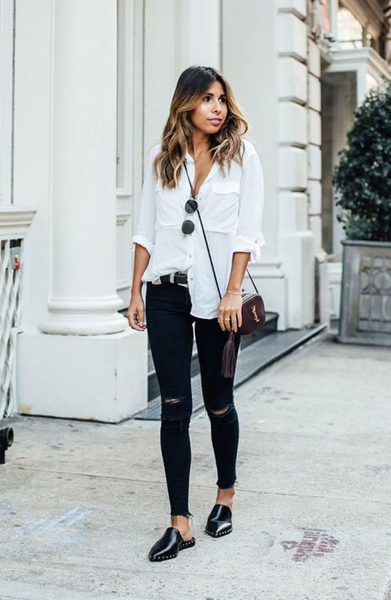 a comfy look with a white button down, black ripped skinnies, black mules and a burgundy bag