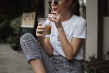 07 a graphic tee, checked cropped pants and white sneakers make up a cool and comfy summer outfit