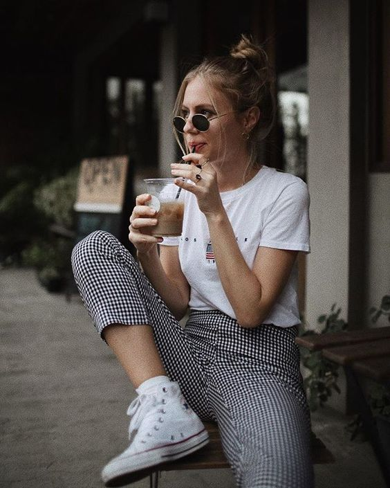 a graphic tee, checked cropped pants and white sneakers make up a cool and comfy summer outfit