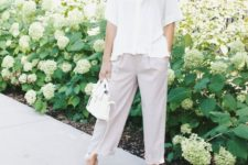 07 a relaxed summer outfit with a white button down with short sleeves, lavender pants and matching shoes and a white bag