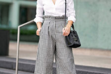 07 a white button down, checked high waisted pants, a black bag and black shoes for a monochromatic look
