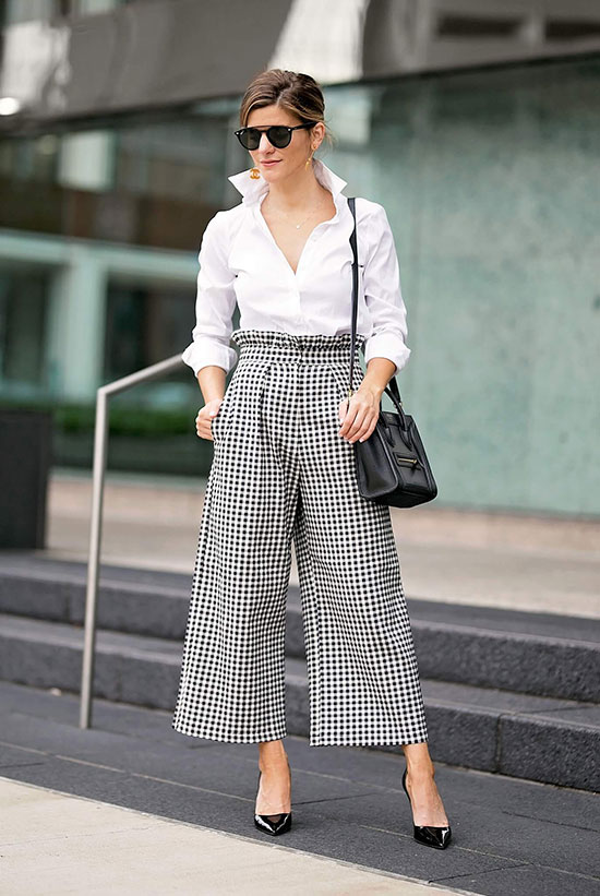 a white button down, checked high waisted pants, a black bag and black shoes for a monochromatic look