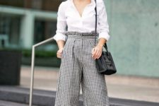 07 a white button down with long sleeves, gingham culottes, black heels and a black bag