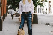 an edgy summer look with mom jeans and a lace blouse