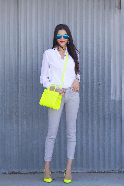 a white shirt, grey skinnies, neon yellow heels and a matching bag that make the look pop