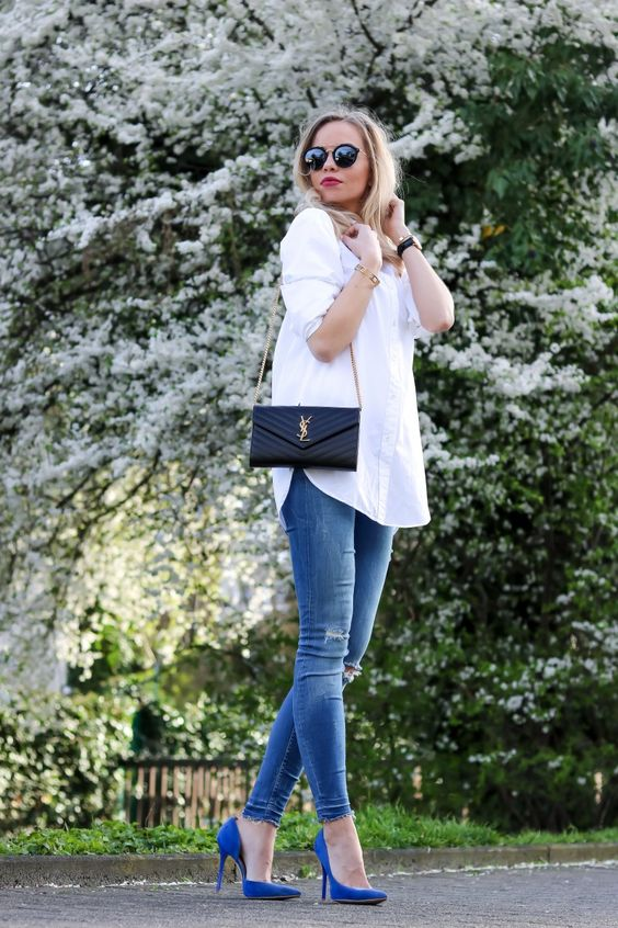 an oversized white button down, blue ripped skinnies, bright blue heels and a black clutch