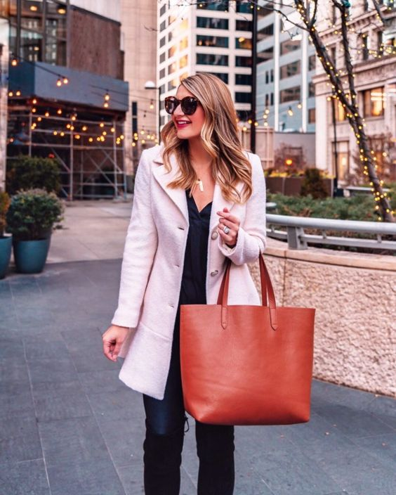 a large amber leather tote bag will add a colorful touch to your work outfit