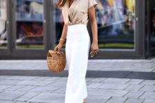 08 a tan silk blouse with a V-neckline, short sleeves, white wideleg pants, nude shoes and a wooden bag